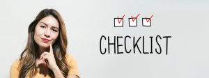Woman looks dubiously at check list with checked boxes