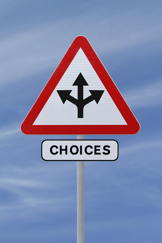Triangular sigh with 3 arrows pointing in different directions from a single source. Below reads: Choices