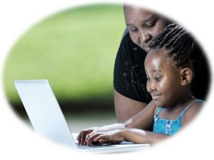 Parent supervising child using a laptop