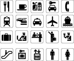 Commonly used travel icons including Knife/fork, coffee, gifts, locksmith, phone, train, helicopter, car, plane, boat, suitbase, security, service, assistance, police, escalator, lockers, elevator, men's and women's lavatory