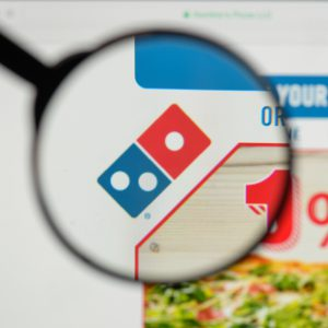 Closeup of Domino's pizza logo on their website