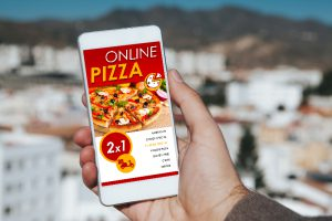 Online pizza app shown on phone