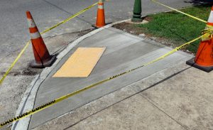 Newly installed curb cut which provides solutions for everyone.