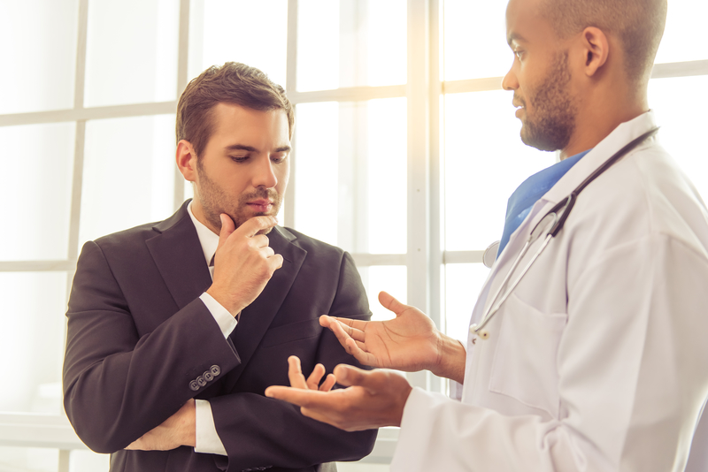 Healthcare provider speaking with patient