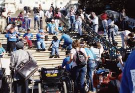 disabled protestors on the steps of Capitol Hill