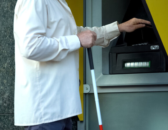 BLind person using an ATM for online accessibility