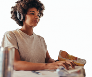 Woman comparing PDF remediation pricing online wearing headphones.