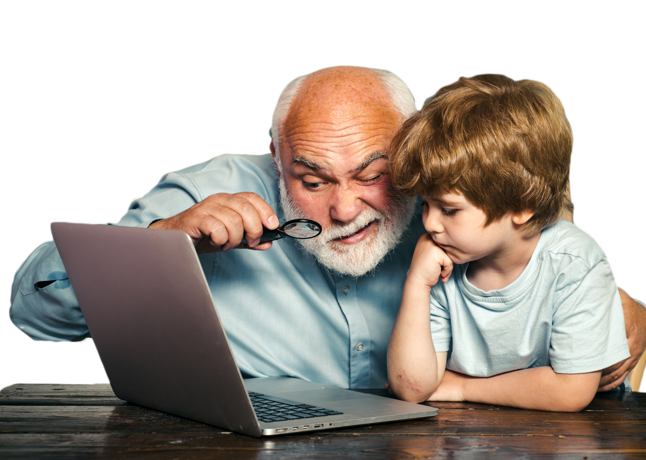 Parent helping a child learn remotely on a laptop