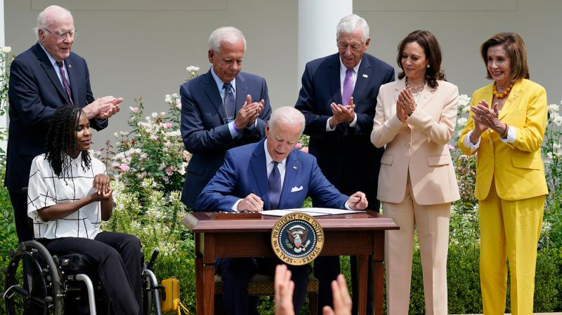 President Biden signing a disability proclamation